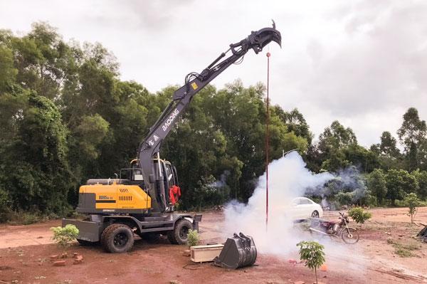 轮式挖掘机抓木机油耗