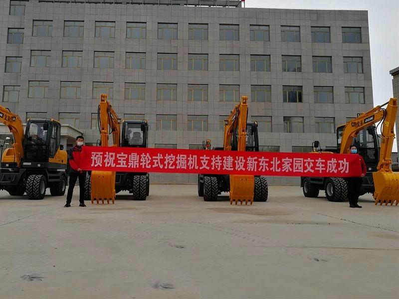 宝鼎公司中标辽宁轮式挖掘机项目21台顺利交机-宝鼎轮式挖掘机厂家